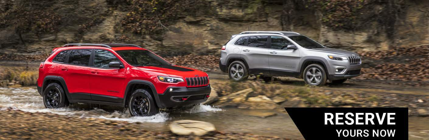 Limited and Trailhawk trims of the 2019 Jeep Cherokee driving along or in a creek