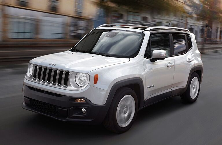 white 2019 Jeep Renegade driving in the city