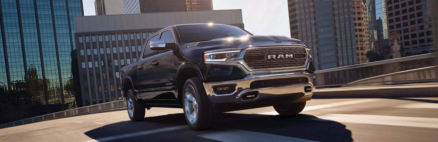 black 2019 Ram 1500 driving on a raised highway through a city