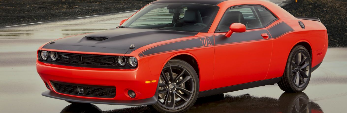 2020 Dodge Challenger on water-slicked pavement