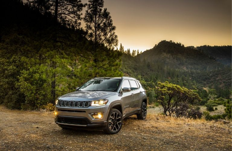 2020 Jeep Compass in front of scenic nature landscape