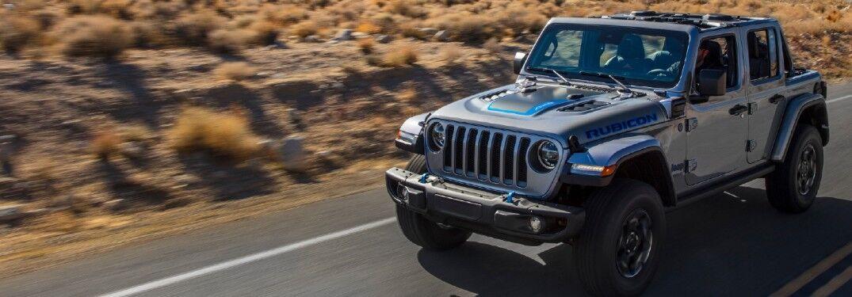 2021 Jeep Wrangler on rock-lined desert highway