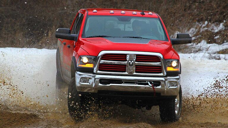red 2016 Ram 2500 in the mud