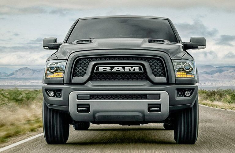 bold grille view of the 2017 Ram 1500 Rebel on the road