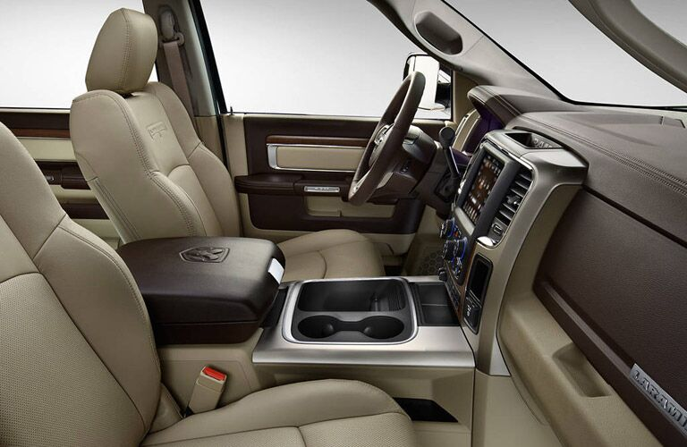 spacious front seats and central console of the 2017 Ram 3500
