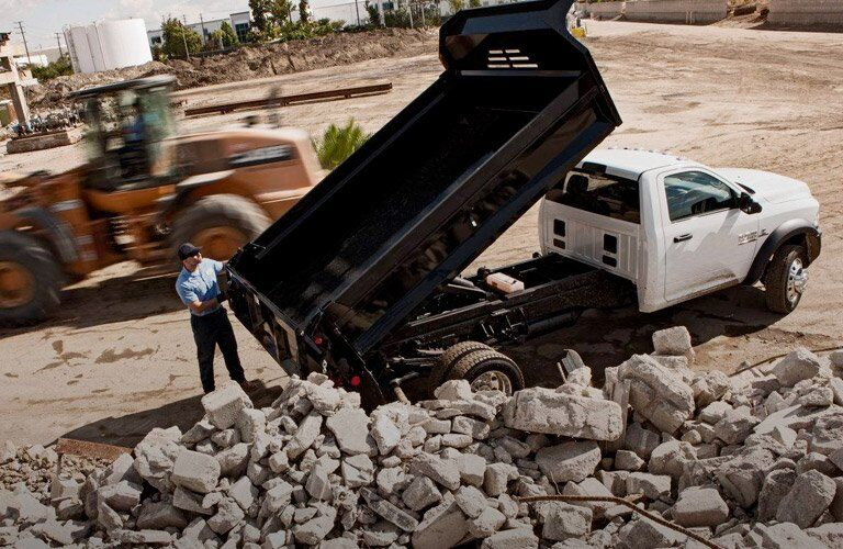 2017 Ram 5500 Chassis Cab dump truck on a worksite