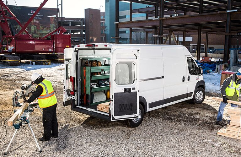 white 2017 Ram ProMaster Cargo Van on a work site