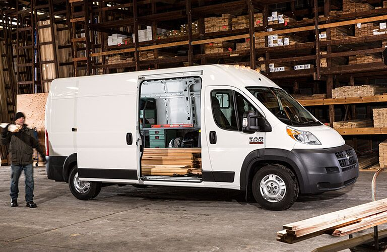 white 2017 Ram ProMaster Cargo Van with a side door open showing cargo and storage