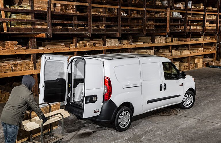 2017 Ram ProMaster Cargo Van being loaded with lumber in a warehouse