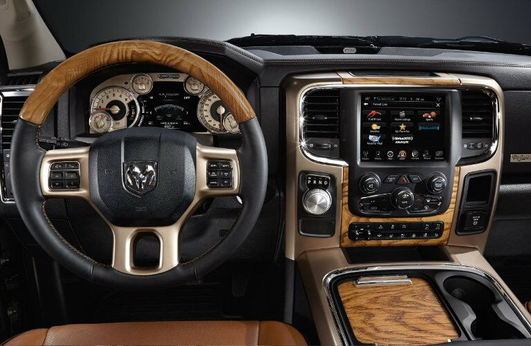 luxurious steering wheel and infotainment system in the 2017 Ram 1500 Laramie Longhorn