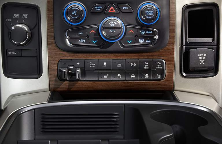 dials and buttons of the infotainment system of the 2018 Ram 3500 as seen from the central console