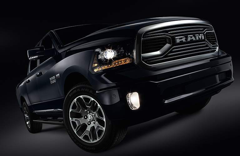 tilted view of the unique grille and wheel color of the 2018 Ram Limited Tungsten Edition