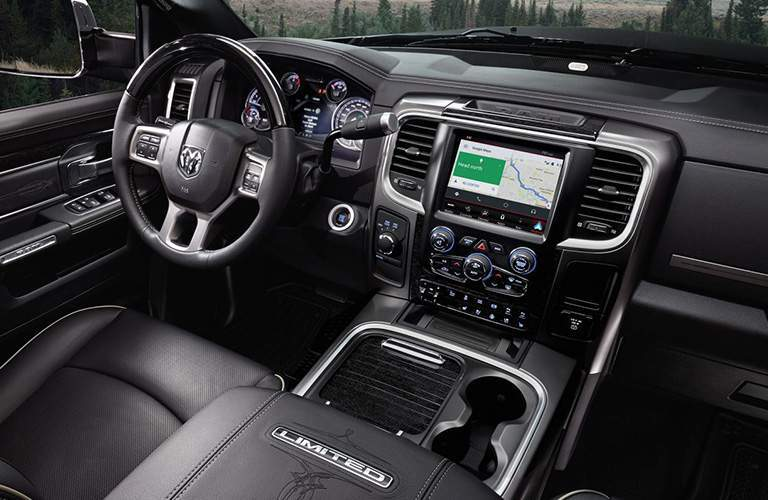 steering wheel and Uconnect system in the 2018 Ram 2500 Limited