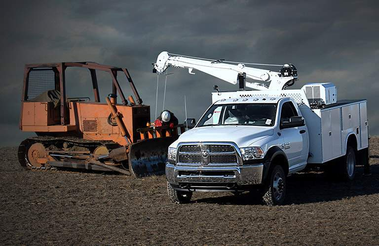 2018 Ram 5500 Chassis Cab next to a plow