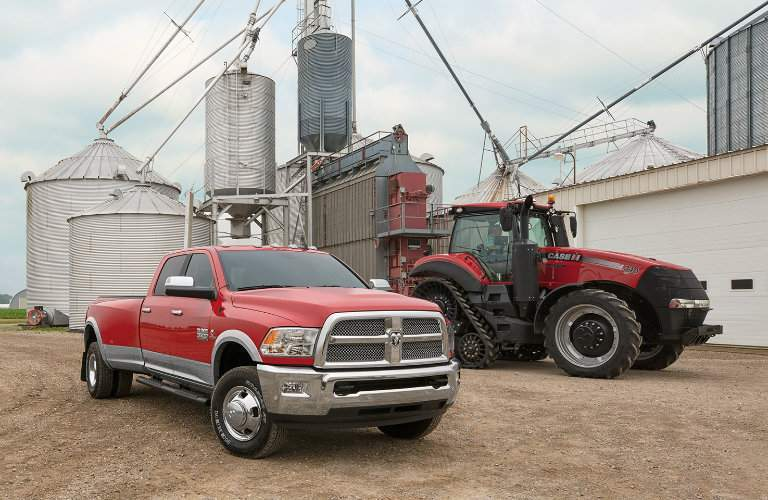 2018 Ram Harvest Edition in Case IH Red in front of a silo