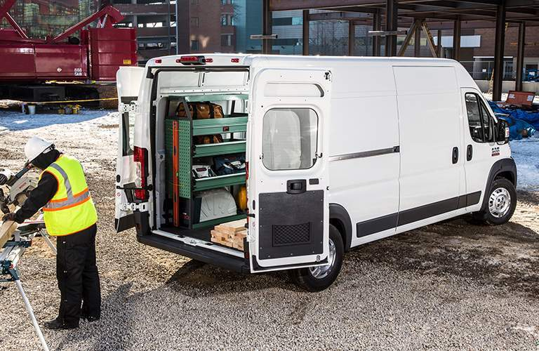 white 2018 Ram ProMaster carrying materials on the worksite