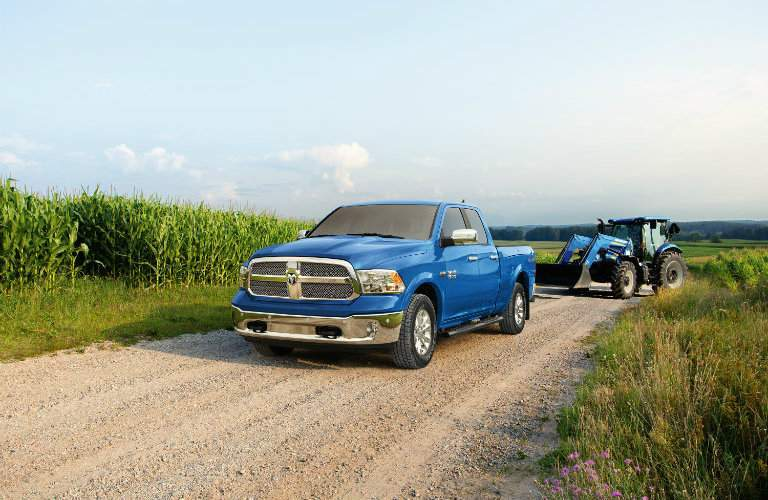 2018 Ram Harvest Edition in New Holland Blue parked in a cornfield