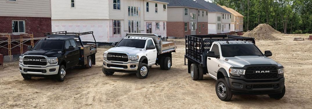 three 2019 Ram 4500 Chassis Cab construction vehicles on construction site