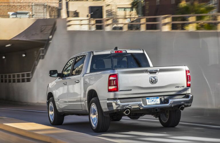 rear of the 2019 Ram 1500 on a city highway