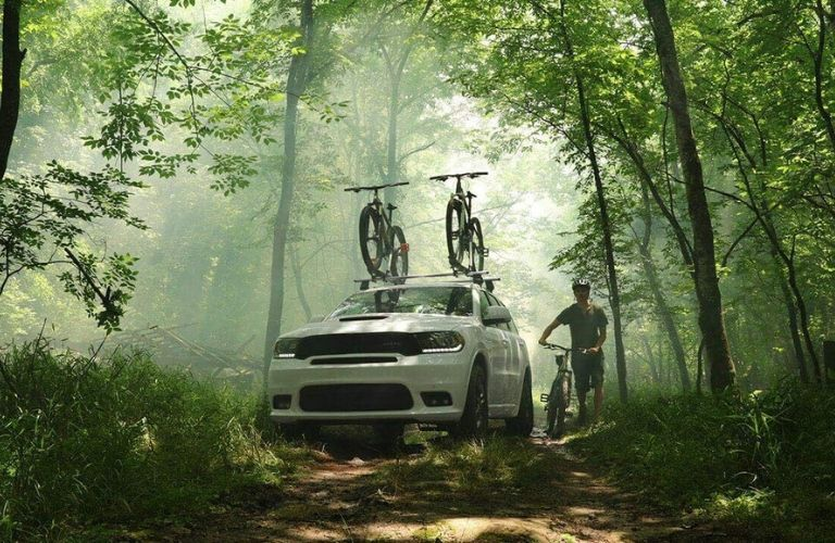 2020 Dodge Durango with bikes on forest trail