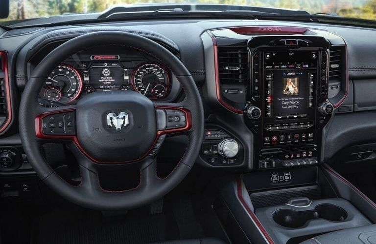 Interior view of the steering wheel and touchscreen inside a 2020 RAM 1500