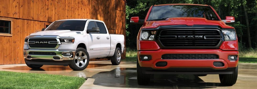 two 2020 Ram 1500 models on driveway pavement