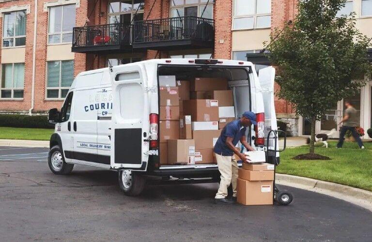 2021 RAM ProMaster Cargo Van in apartment building parking lot