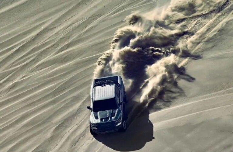 2021 Ram 1500 TRX driving down sand dune
