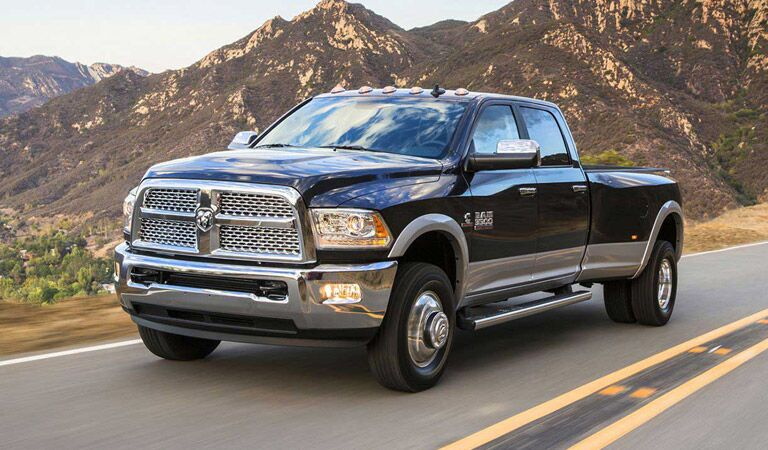 2016 Ram 3500 driving against a backdrop of mountains