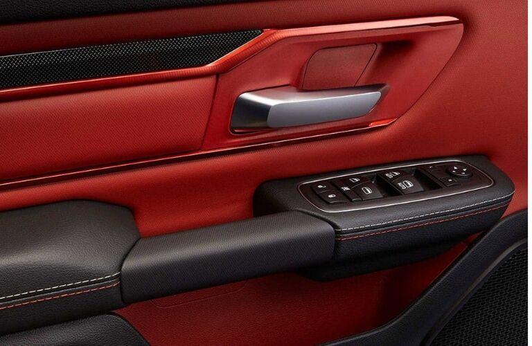 Red and black interior door in 2019 Ram 1500 Rebel