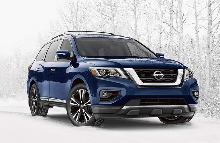 blue 2017 Nissan Pathfinder parked in snow