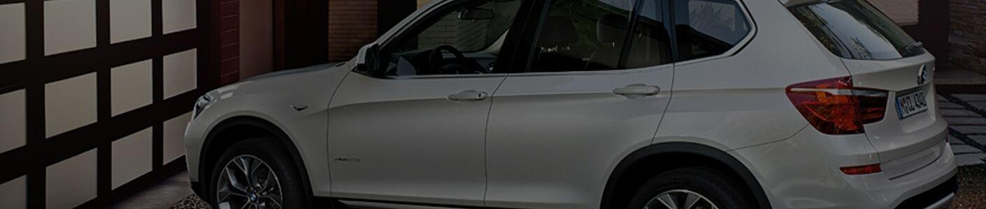 2017BMWX3/2017_BMW_X3_white_side_driveway_sleek