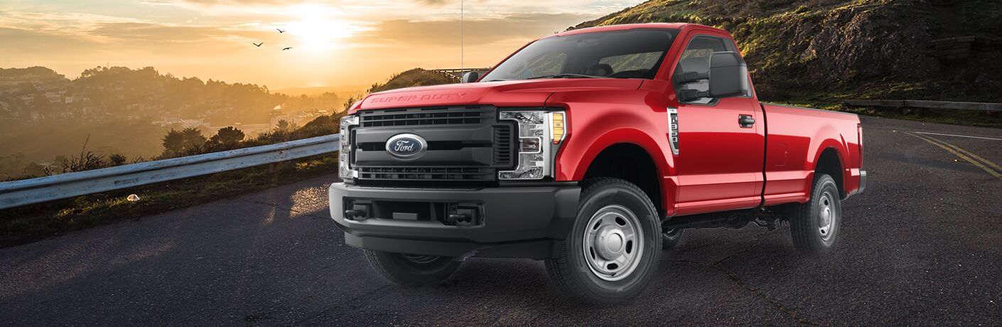 Red 2018 Ford F-350 Super Duty Lariat parked on mountainous road
