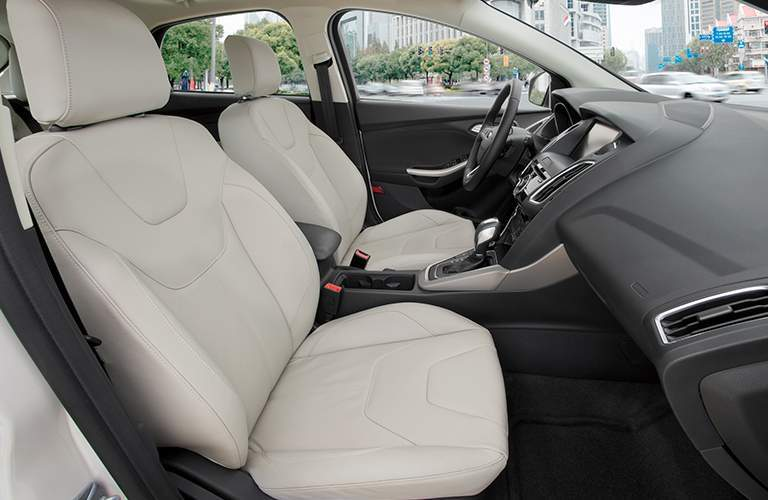 Front two seats of 2018 Ford Focus with steering wheel in fram