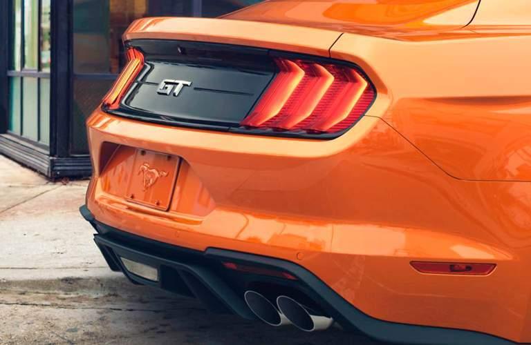 Rear shot of orange 2018 Ford Mustang