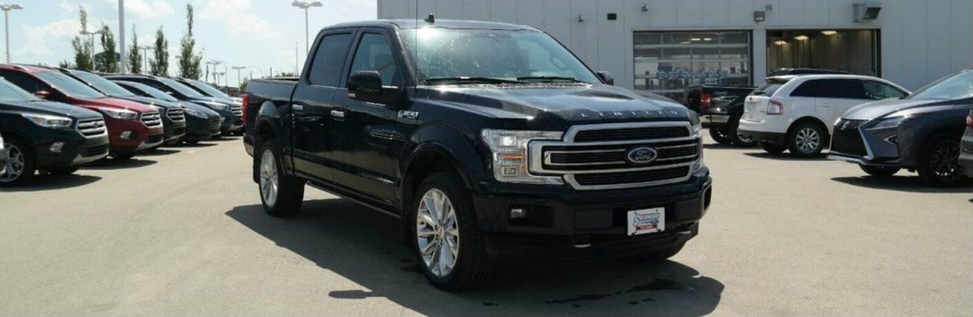 Black 2018 Ford F-150 Limited parked in front of Sherwood Ford