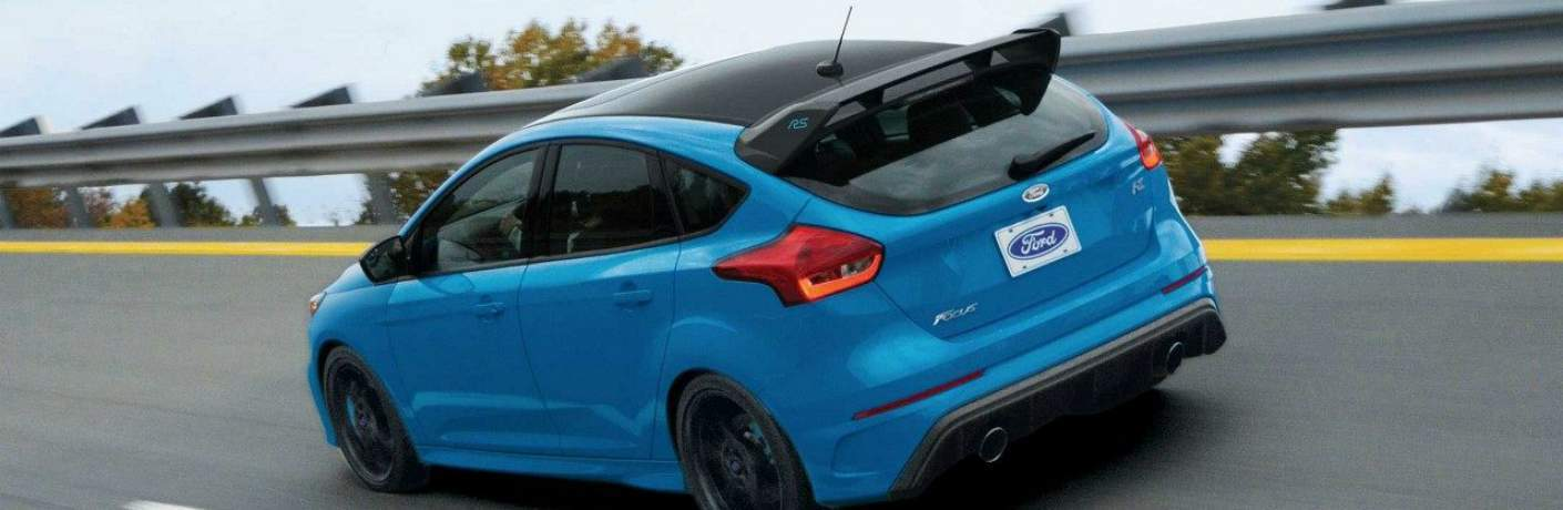 2018 Ford Focus RS Rear View with Spoiler Driving Through a Curve