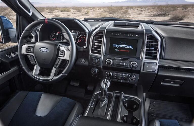Front steering wheel and touchscreen of 2019 Ford F-150 Raptor