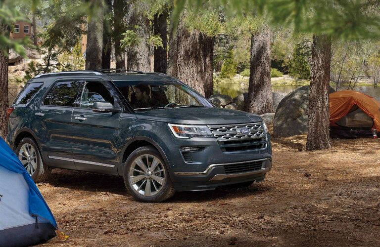Blue 2019 Ford Explorer parked at campsite