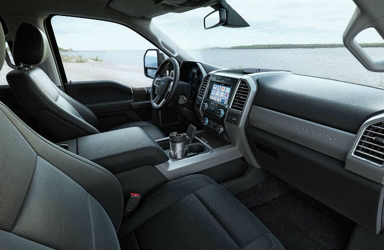 Interior seats and dashboard of 2019 Ford Super Duty F-350 Lariat