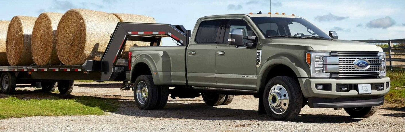 2019 Ford Super Duty F-350 Platinum towing hay bales