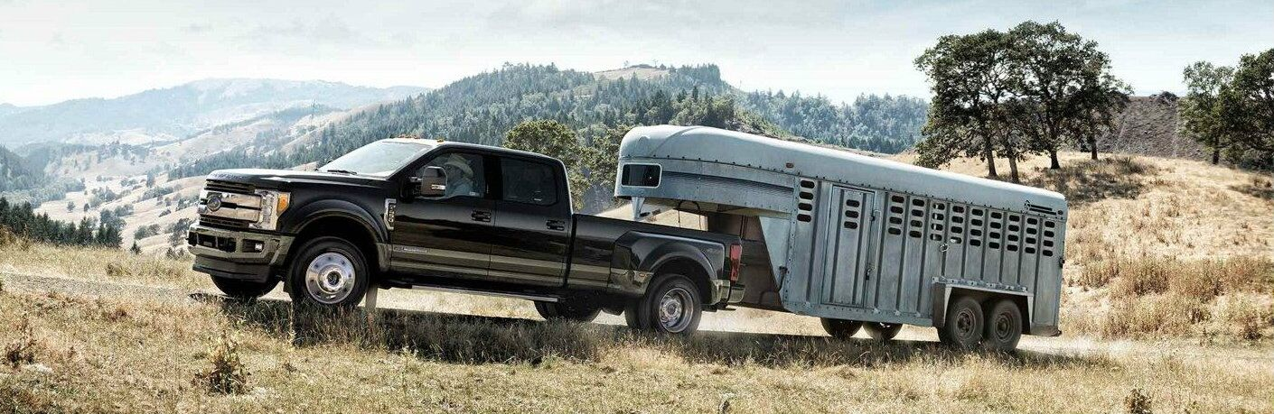 Black 2019 Ford Super Duty F-350 King Ranch towing trailer