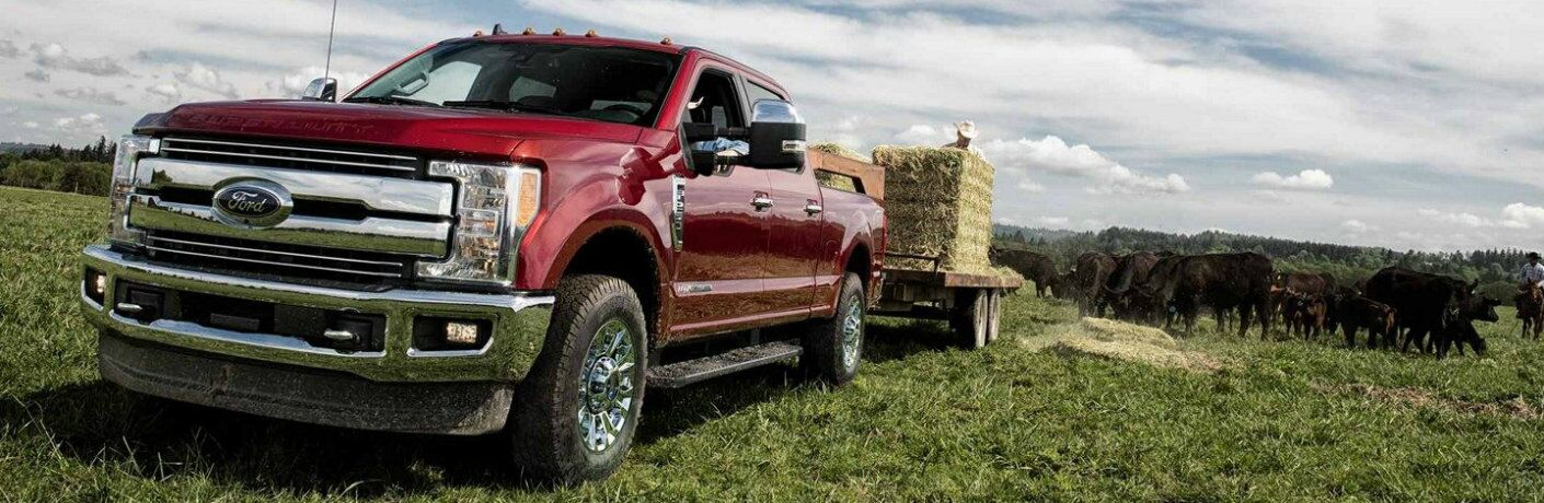 2019 Ford Super Duty F-350 Lariat towing hay bales in field