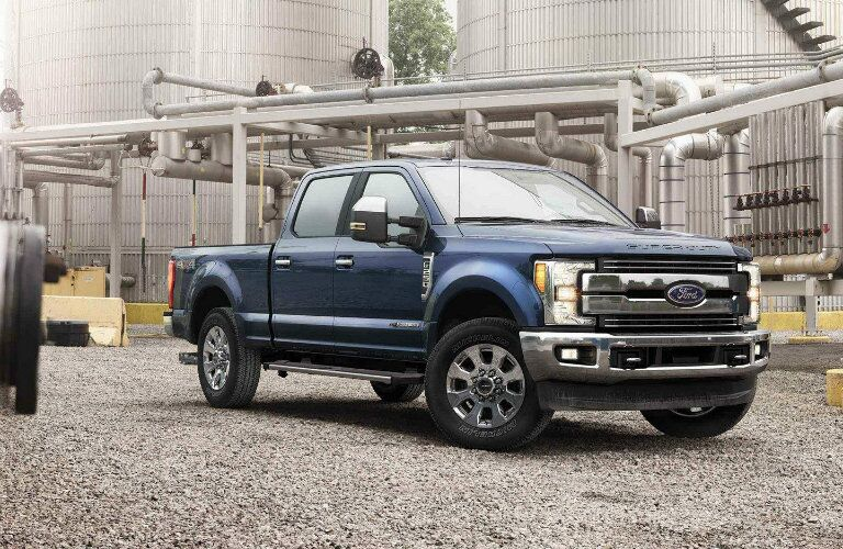 Blue 2019 Ford Super Duty F-350 Lariat parked at worksite
