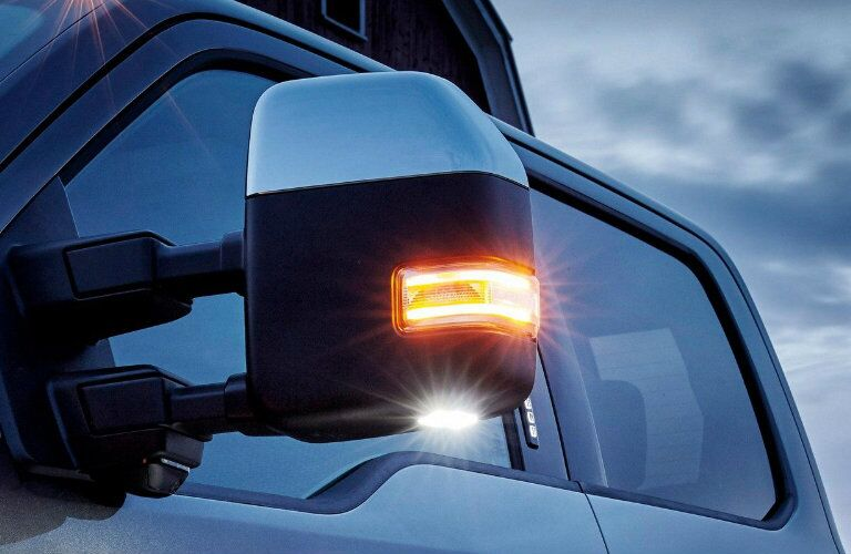 Driver side mirror of blue 2019 Ford Super Duty F-350 Limited