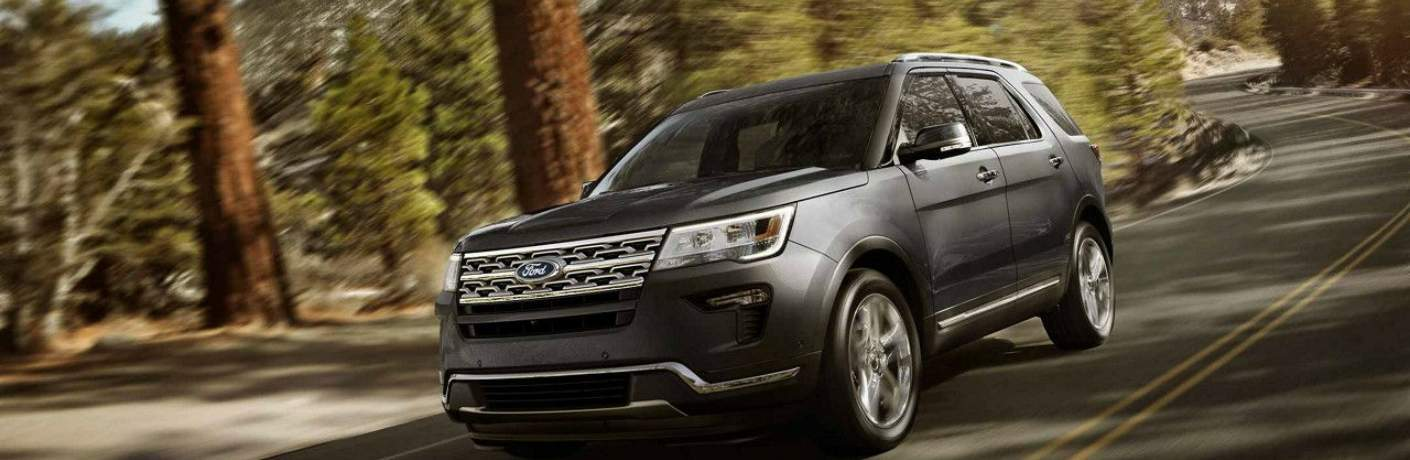 2018 Explorer Limited Driving Through the Forest