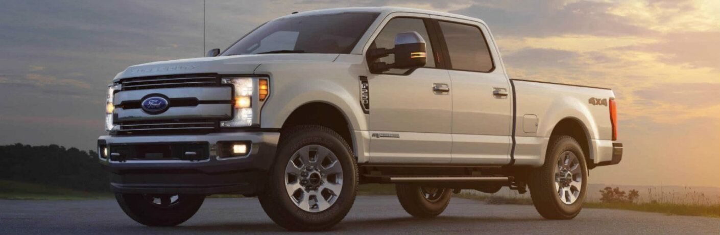 Profile view of white 2018 Ford Super Duty F-250 at dusk