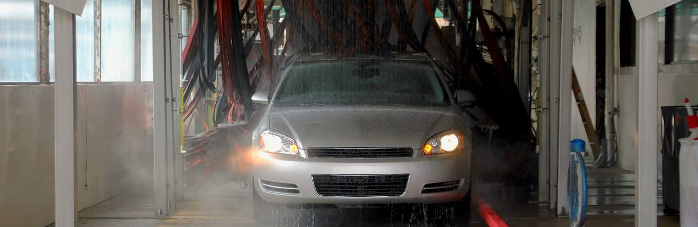 Silver Sedan Going Through Car Wash