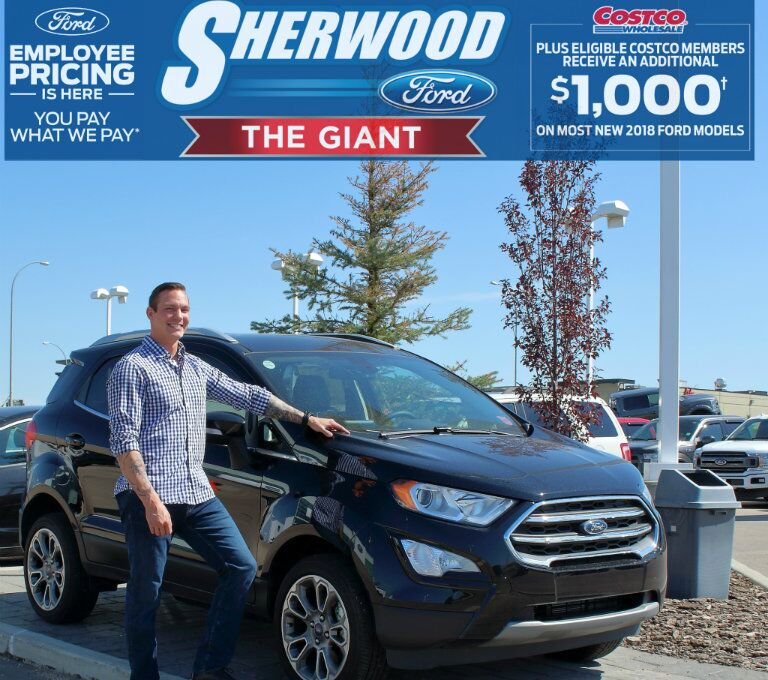 Scott from Sherwood Ford standing in front of 2018 Ford EcoSport