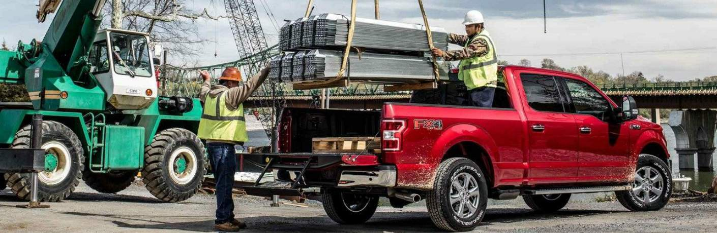 Two Men Loading Up the Bed of the 2018 F-150 XLT